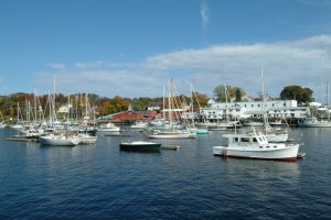 Pleasure boats bob on their moorings in the beautiful harbor of Camden, Maine.