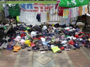 Hats and running shoes left at last year's Boston Marathon memorial. Photo (c) Nathaniel Hammond