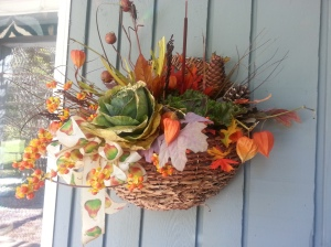A basket of fall flowers brightens a cool autumn day.  Photo (c) Karen Hammond